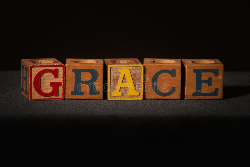 Wooden blocks spelling out the word grace royalty free stock photos