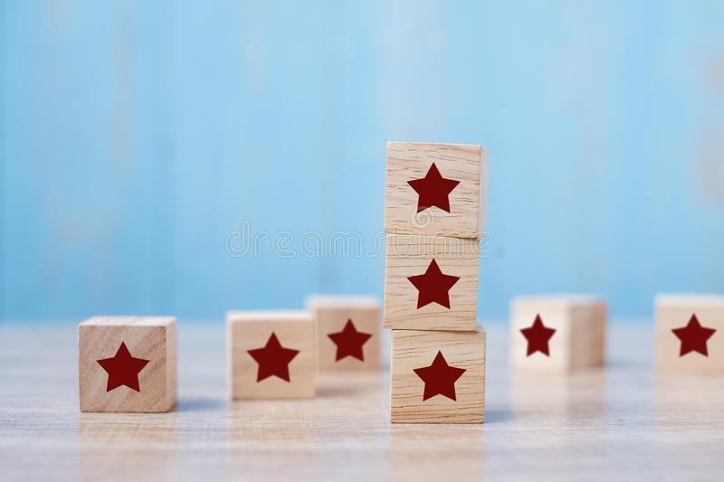 Wooden blocks with the star symbol. Customer reviews, feedback, rating, ranking and service concept.  stock images