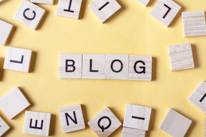 Wooden blocks with the word BLOG. Wood ABC. stock photo