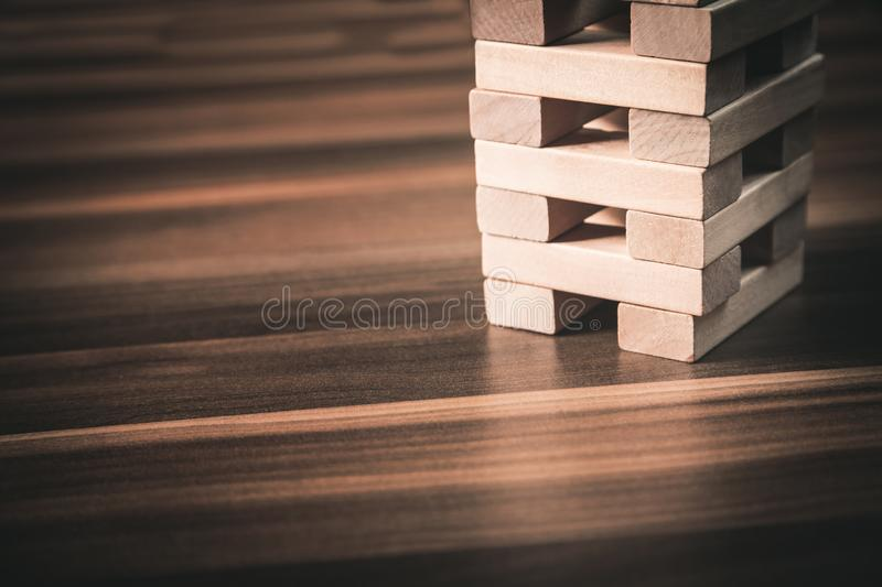 Wooden blocks on wood desk. Development concept. royalty free stock photos