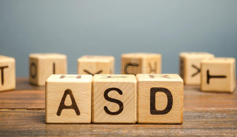 Wooden blocks with the word ASD - Autism Spectrum Disorder. Neurological and developmental disorder stock photography
