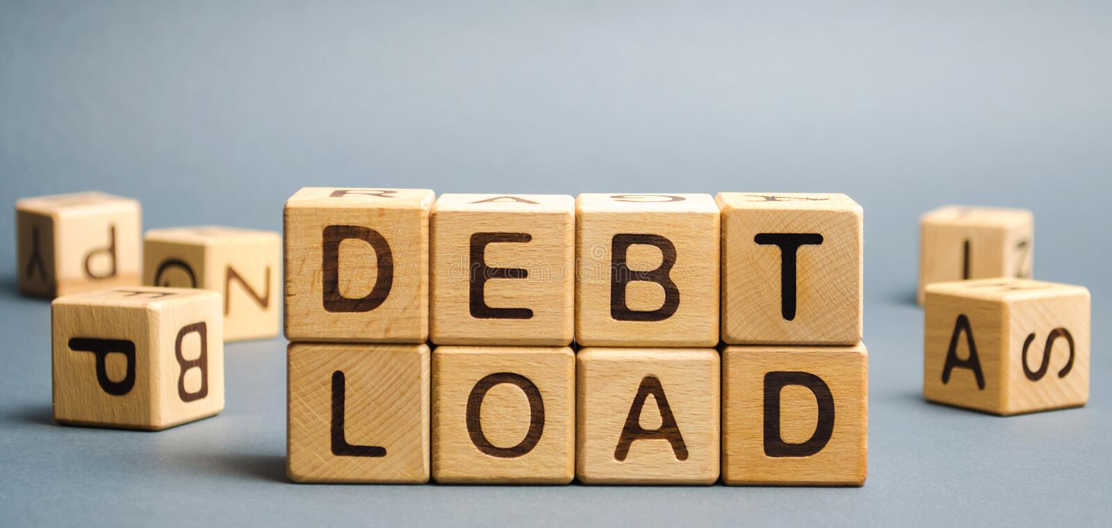 Wooden blocks with the word Debt load. The total amount of debt that a company has on its balance sheet. Financial performance of. The company. Business and stock image