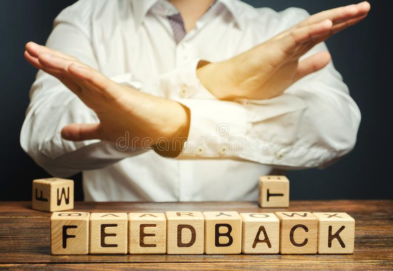 Wooden blocks with the word Feedback and critic. The concept of the bad rating of hotels and restaurants. The evaluation of. Visitors. Quality level, low stock images