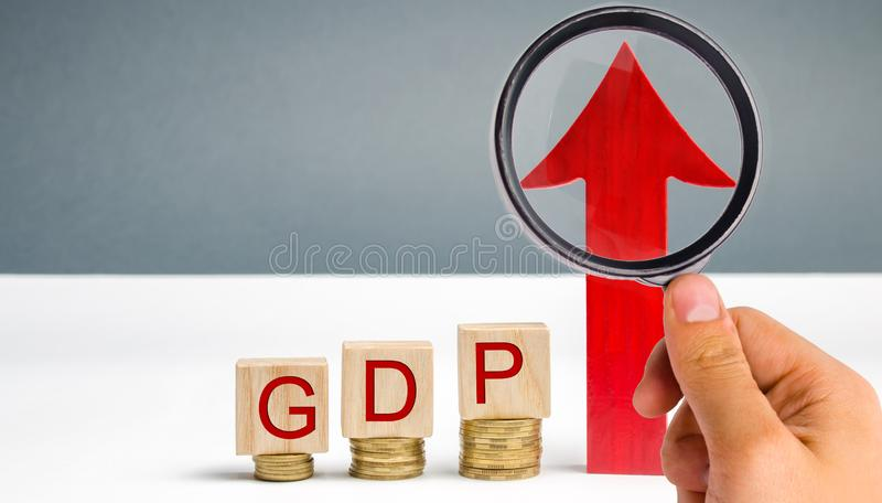 Wooden blocks with the word GDP and up arrow. Technological progress, increasing the level of workers, improving the allocation of. Resources, improving the stock image