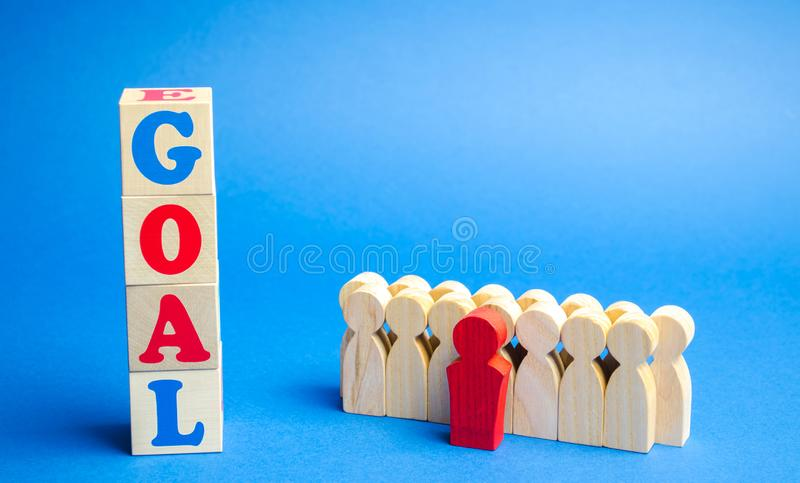 Wooden blocks with the word Goal and business team. Planning financial goals in a company. Business strategy. Cooperation and. Teamwork stock photography