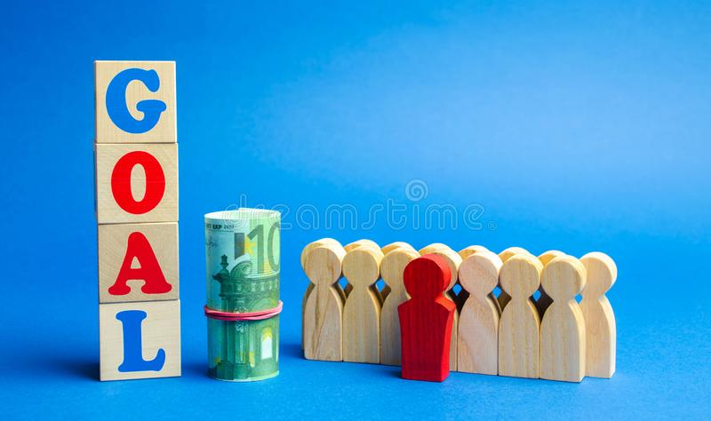 Wooden blocks with the word Goal and business team. Planning financial goals in a company. Business strategy. Cooperation and. Teamwork royalty free stock images