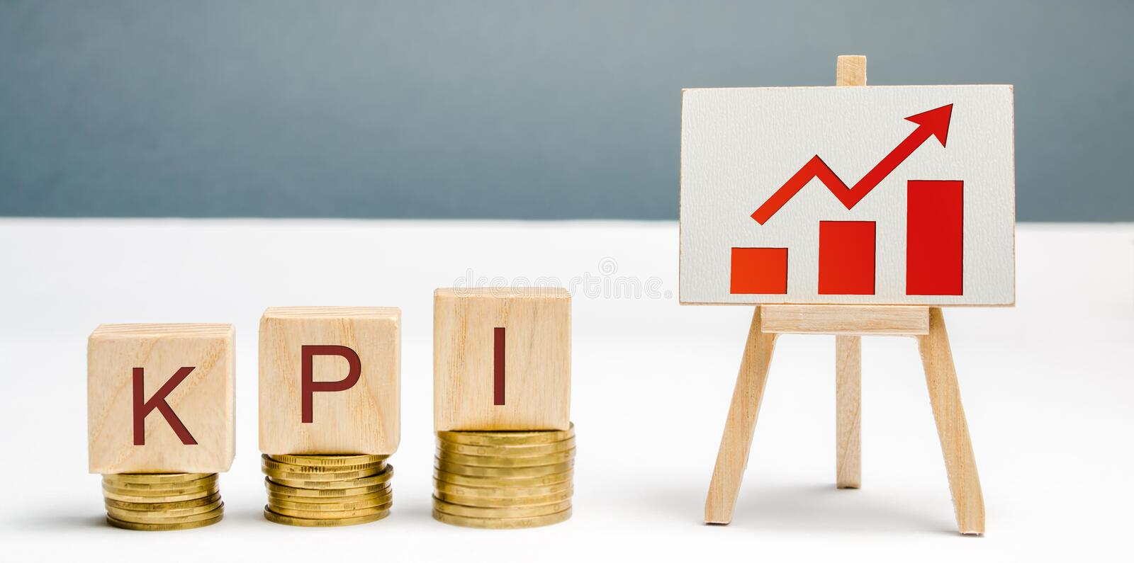 Wooden blocks with the word KPI, the graph with an arrow up. Key Performance Indicator. Planning and implementing a business royalty free stock photo