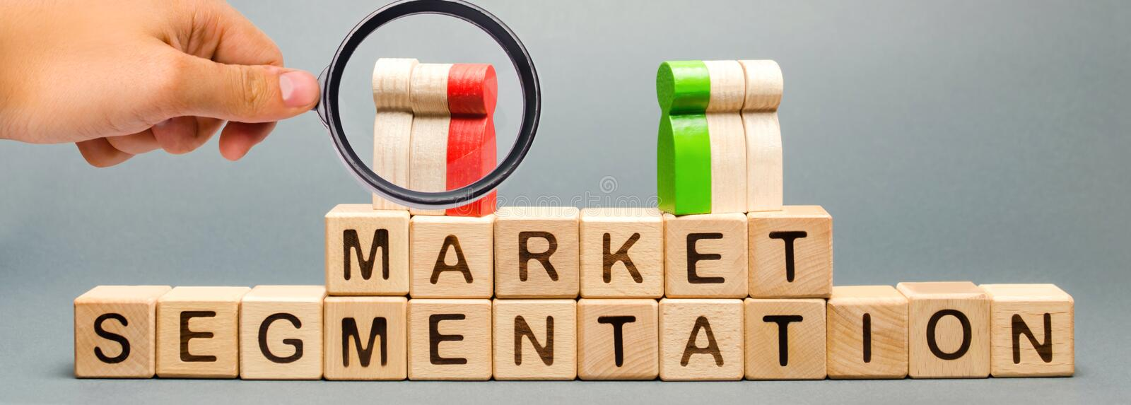 Wooden blocks with the word Market Segmentation and multicolored groups of people. Target audience, customer care. Market group of stock photography