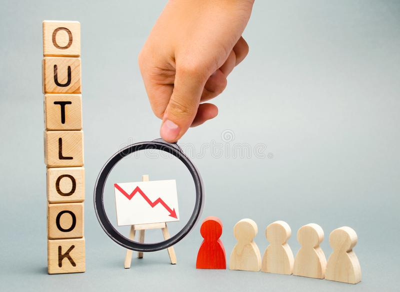 Wooden blocks with the word Outlook, business schedule and a team with a leader. Bad business. Lack of perspective. Unreliable royalty free stock photo