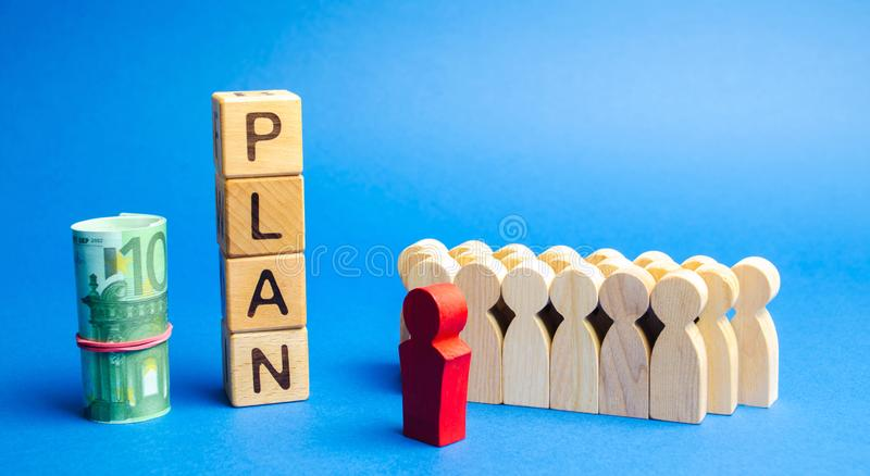 Wooden blocks with the word Plan and a business team standing next to money. Strategy planning. Management business concept. Improving the efficiency of the royalty free stock photos