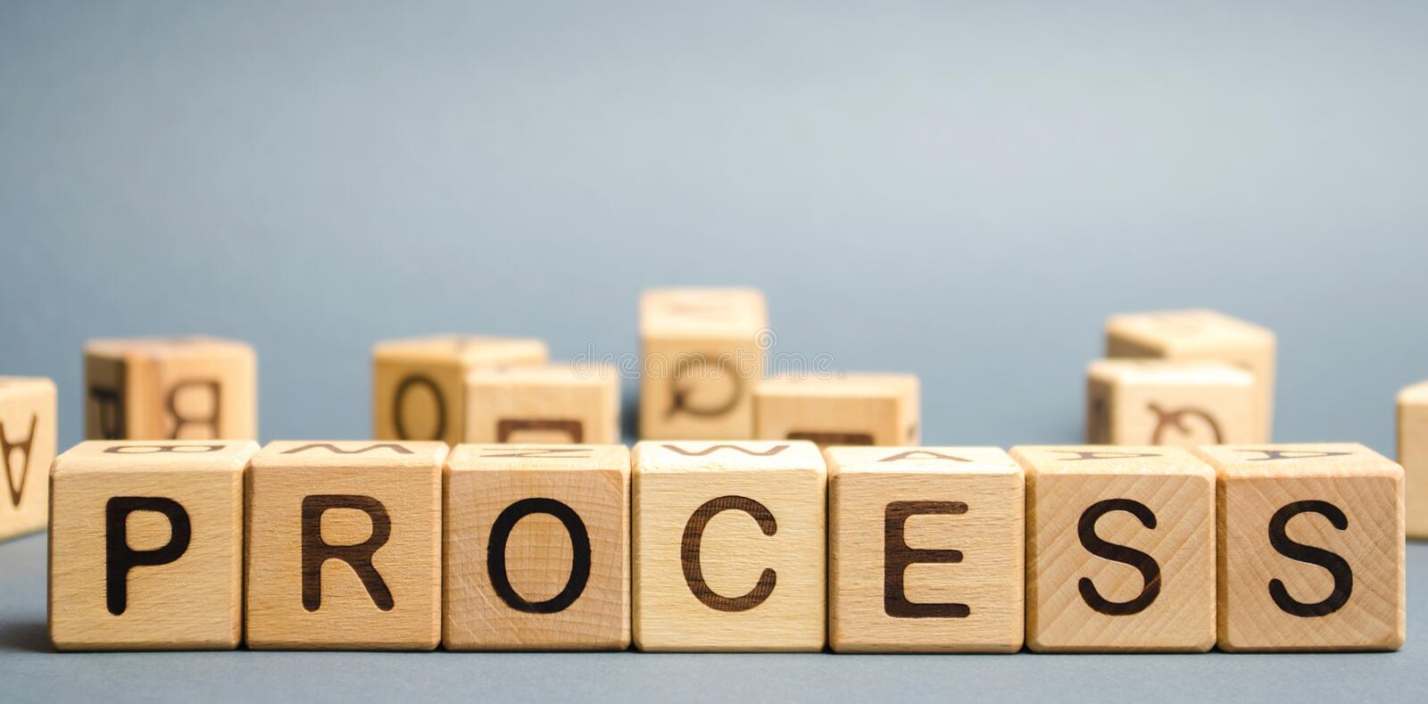Wooden blocks with the word Process. Business management concept. Litigation and technological processes.  royalty free stock photo