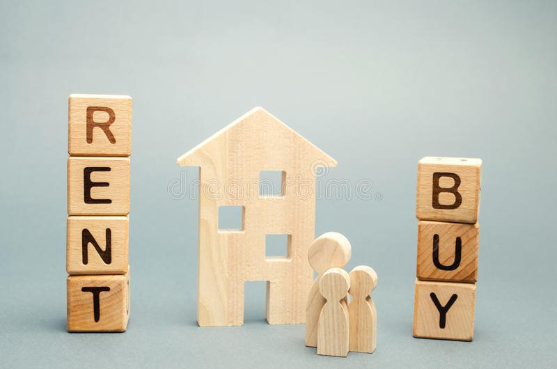 Wooden blocks with the word Rent or buy and a family stands near the house. Make the right decision. Real estate concept. Rent. Apartment. Property. Rental royalty free stock images
