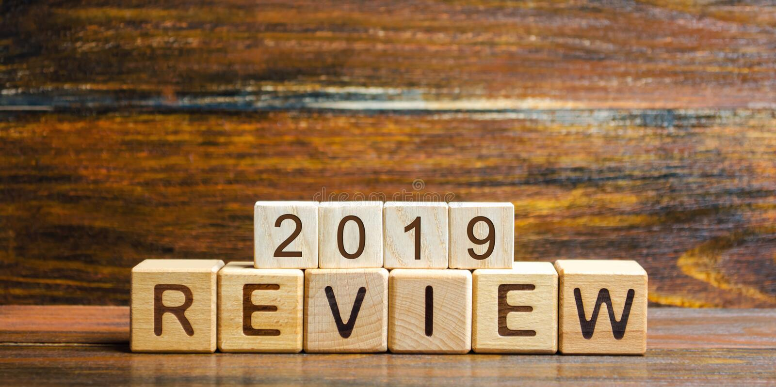 Wooden blocks with the word Review 2019. Business concept. Feedback, Progress. New trends and prospects. Financial performance royalty free stock photo