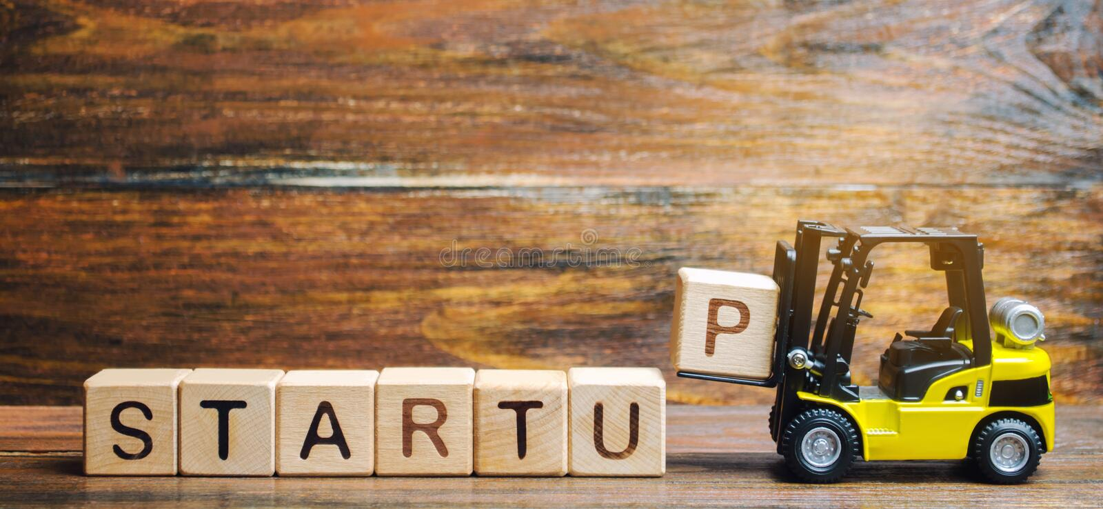 Wooden blocks with the word Startup. Temporary structure designed to find and implement a scalable business model. The concept of. Raising funds for a startup royalty free stock photo