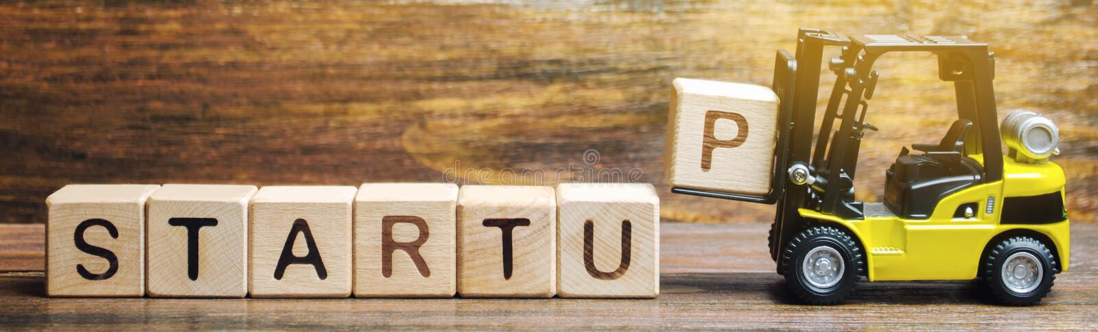 Wooden blocks with the word Startup. Temporary structure designed to find and implement a scalable business model. The concept of. Raising funds for a startup stock images