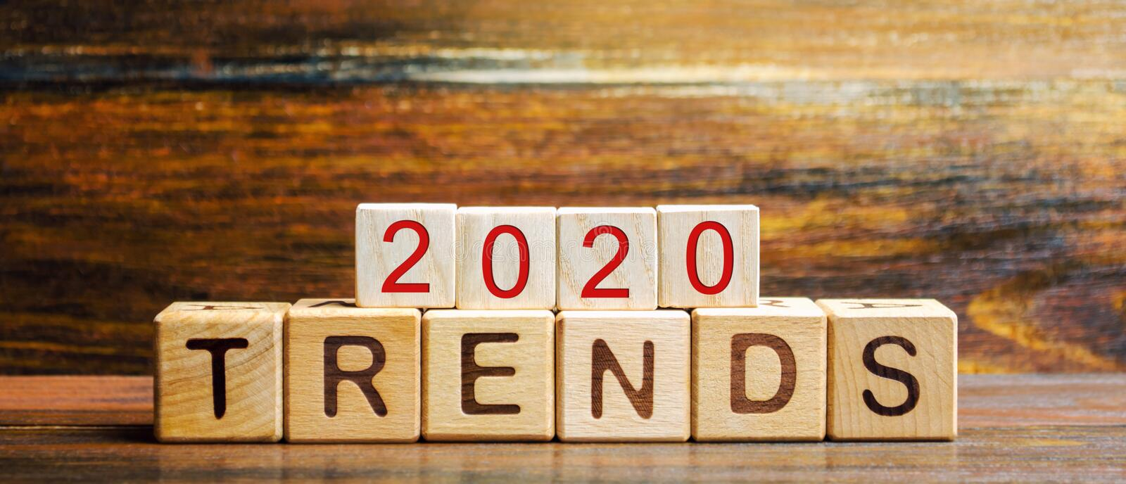 Wooden blocks with the word Trends 2020. Main trend of changing something. Popular and relevant topics. New ideological trends of. Fashion. Recent and latest stock photos