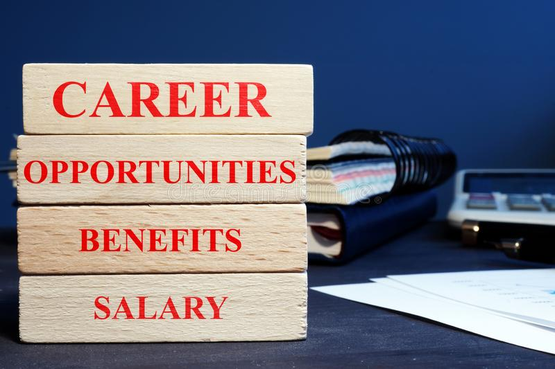 Blocks with words career opportunities, benefits and salary. Wooden Blocks with words career opportunities, benefits and salary royalty free stock photography