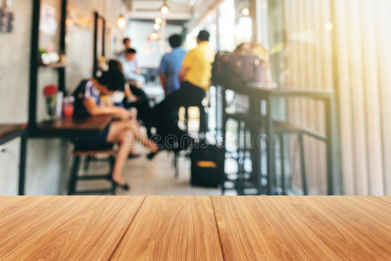Wooden and Blurred soft images of Group businessmen meeting. Planning work together Inside the coffee shop stock photo