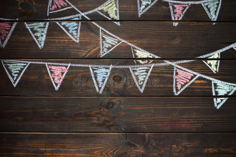 Wooden board background with drawing bunting flags. royalty free stock image