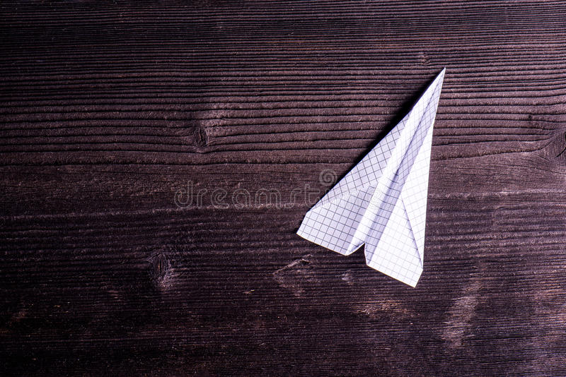 Wooden board background, textured plank, paper airplane, copy sp royalty free stock images