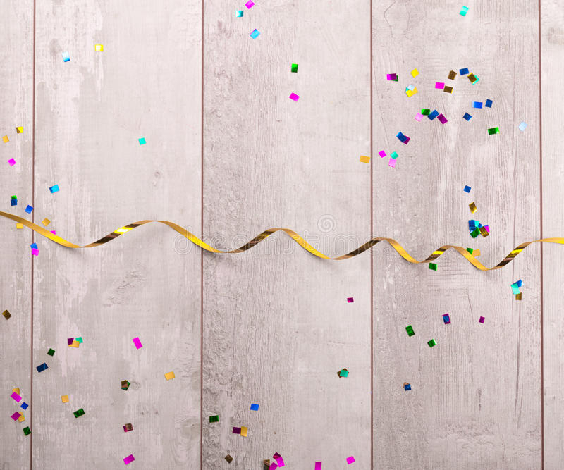 Wooden board with colorful streamers.  stock image
