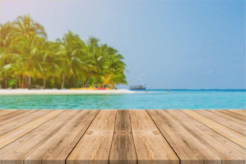 Wooden board empty table in front of blue sea & sky background. royalty free stock image