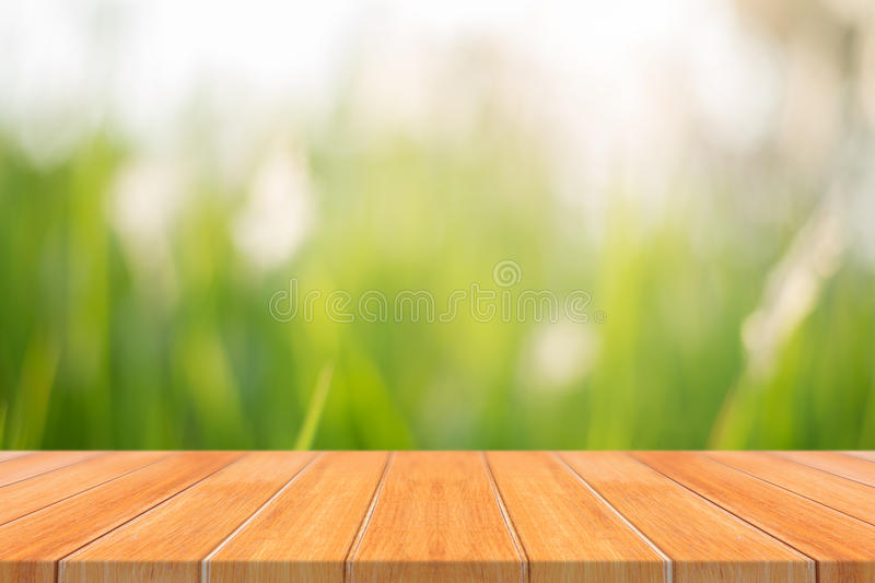 Wooden board empty table in front of blurred background. Perspective brown wood over blur trees in forest - can be used mock up f stock photography