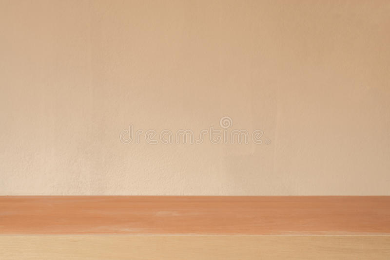 Wooden board empty table in front of cement wall background - ca royalty free stock images
