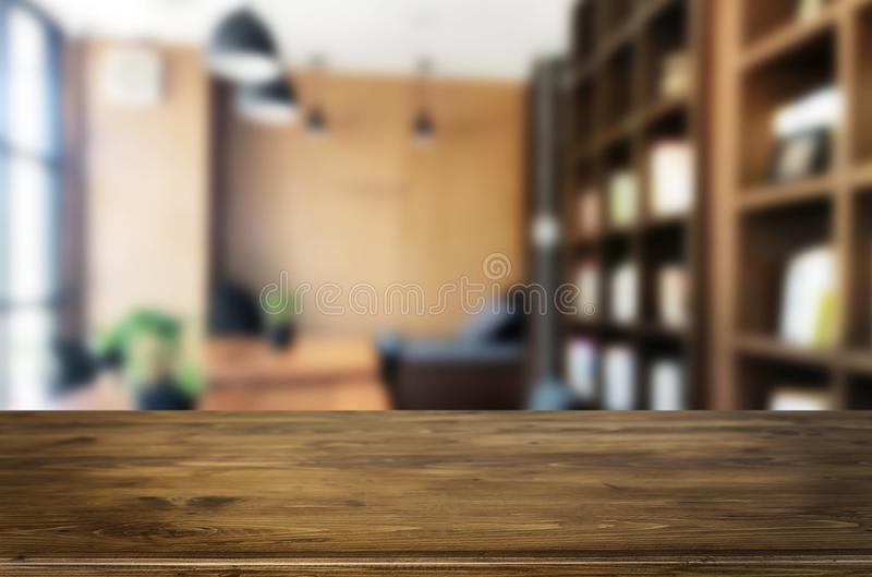 Wooden board empty Table Top And Blur Interior over blur in coffee shop Background, Mock up for display of product royalty free stock image