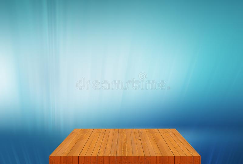 Wooden board empty table top with plain blue background concept. Wooden board empty table top with plain blue background royalty free stock image