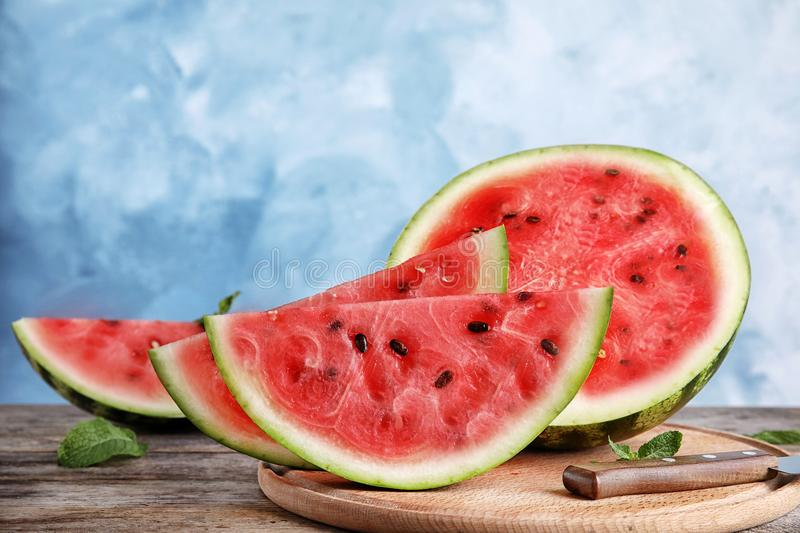Wooden board with juicy watermelon slices. On table royalty free stock photos