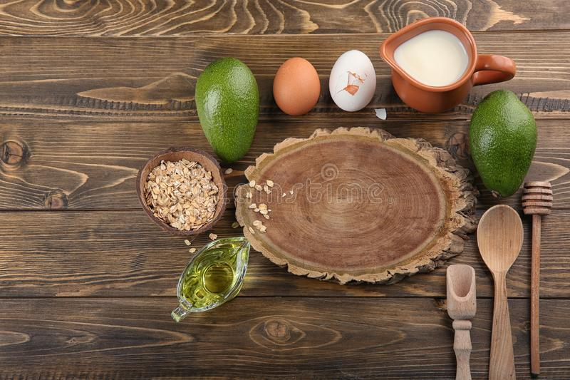 Wooden board and natural ingredients for homemade cosmetics on table royalty free stock image