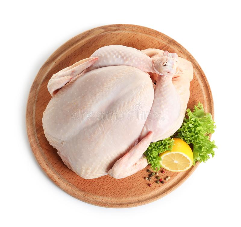 Wooden board with raw turkey and ingredients on white background. Top view stock photography