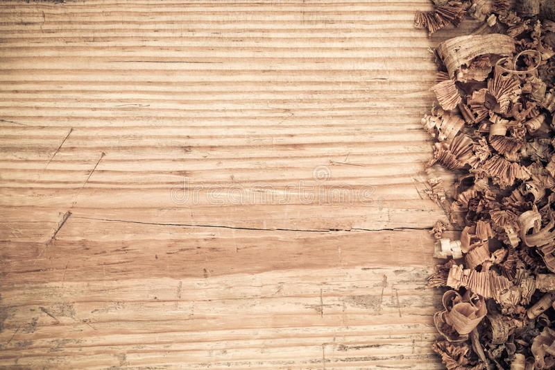 Wooden board with shavings background stock images