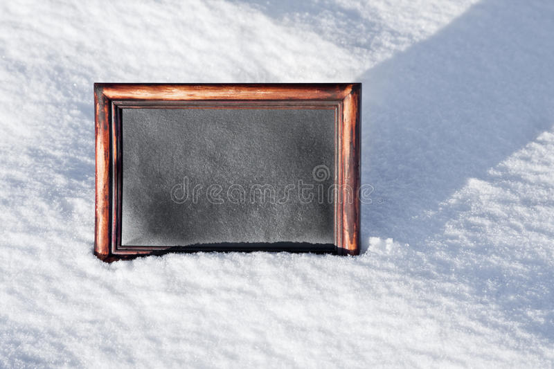 Wooden Board With Space For Text On White Snow Royalty Free Stock Photos