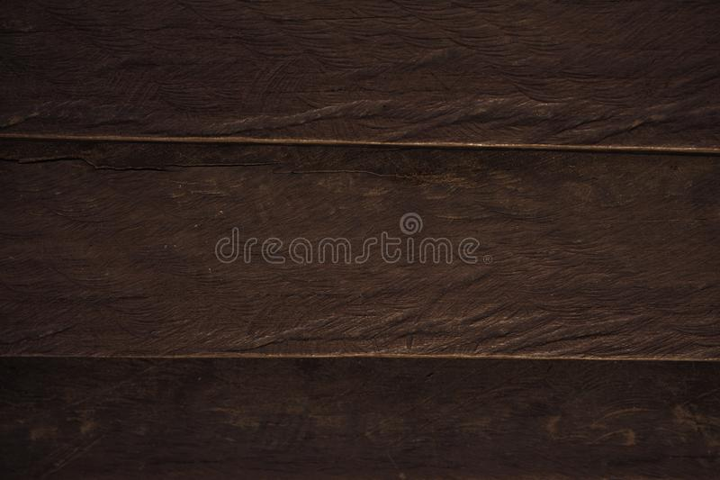 Wooden board top view photo. Timber table surface texture. Brown timber texture backdrop. stock photo