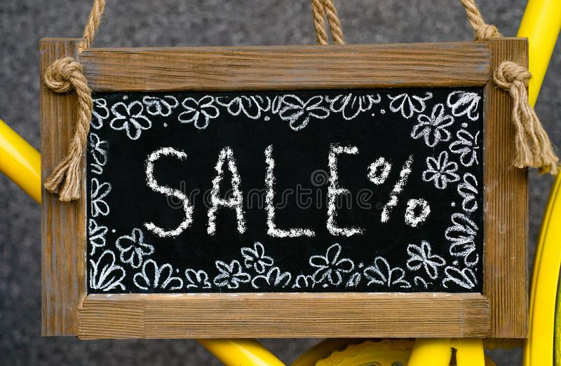 wooden board with word sale written with chalk, signboard. symbol of information, business, marketing and selling stock images