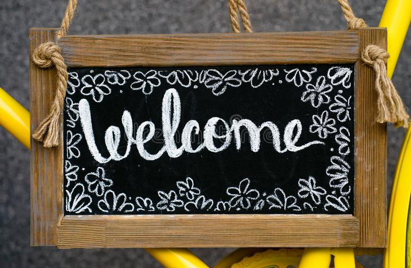 Wooden board with word welcome, signboard. Welcome sign, symbol. Of hospitality stock photo