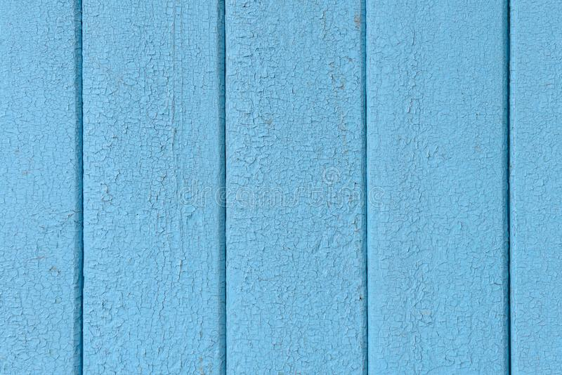 Wooden boards with cracked old blue paint royalty free stock photography