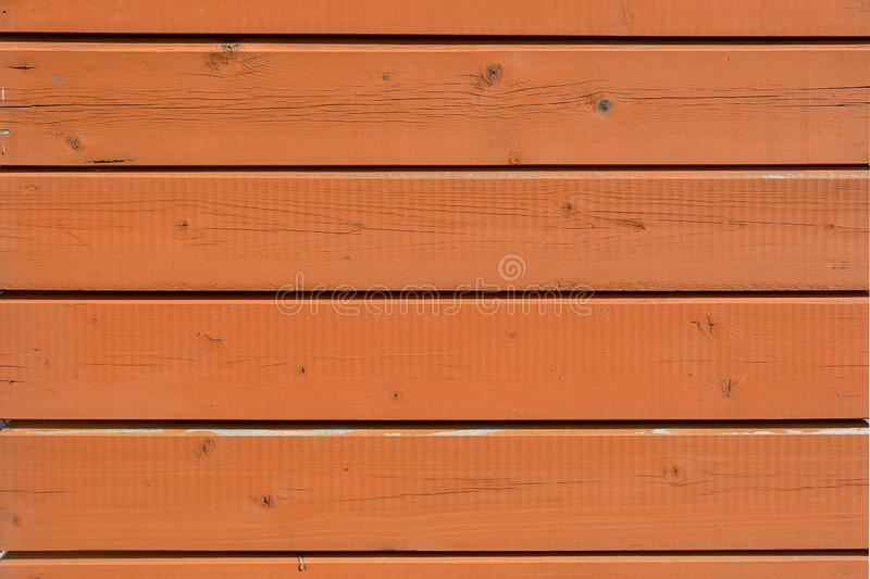 Wooden boards are impregnated with an antiseptic. Photo of wooden boards coated with an antiseptic. Fragment of a wooden structure royalty free stock photos