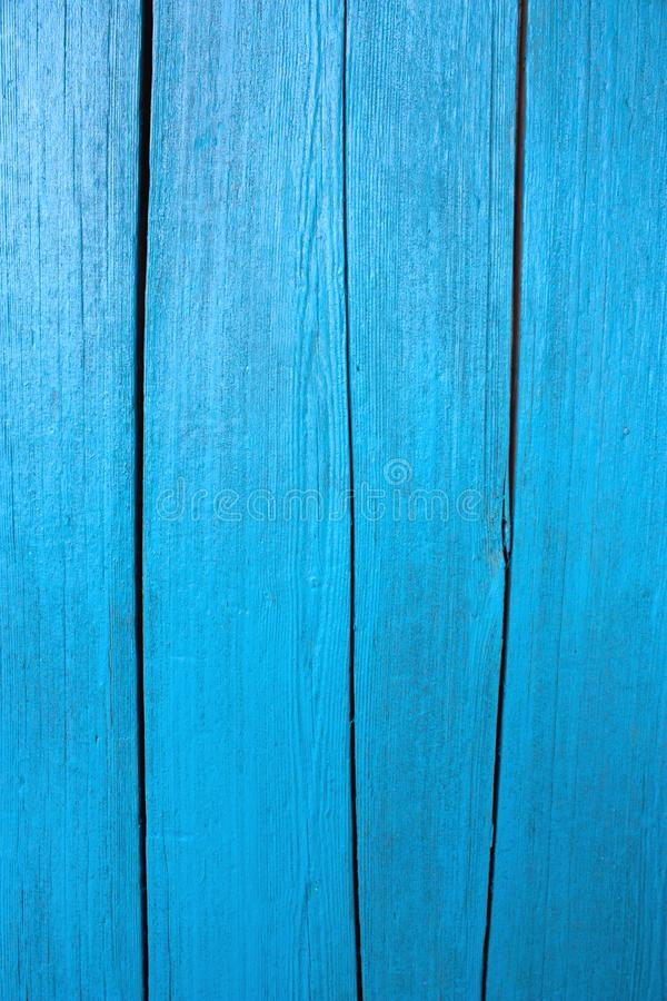 Wooden boards painted in bright blue texture, shabby surface tree with cracks and scratches, old wood board, abstract background, royalty free stock image
