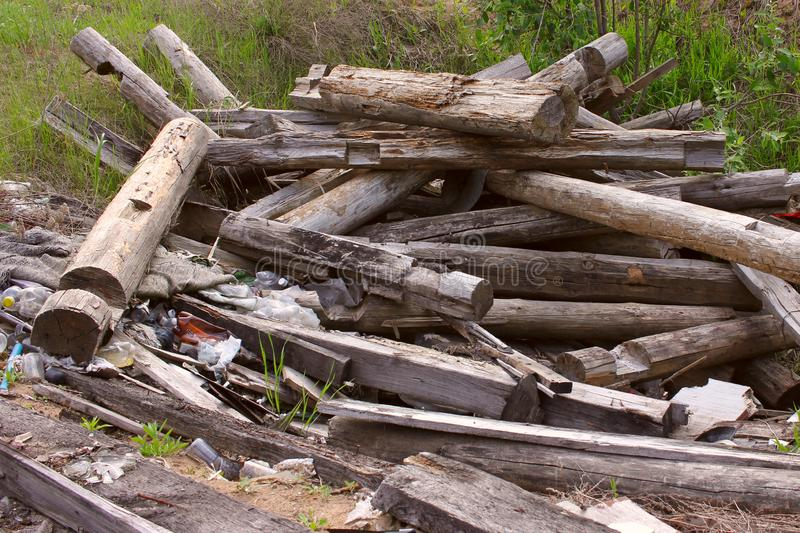 Wooden boards and rubble and the ruins of the house, completely destroyed stock images