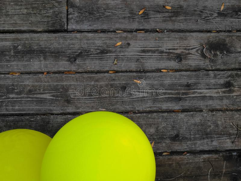 Wooden boards and yellow balloons background. Colorful balloons on wooden table. Blue, bright, decoration, design, holiday, summer, air, anniversary, beautiful royalty free stock photography