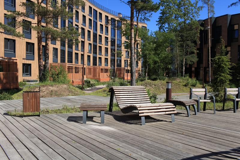 Wooden boardwalk bench in the foreground stock images
