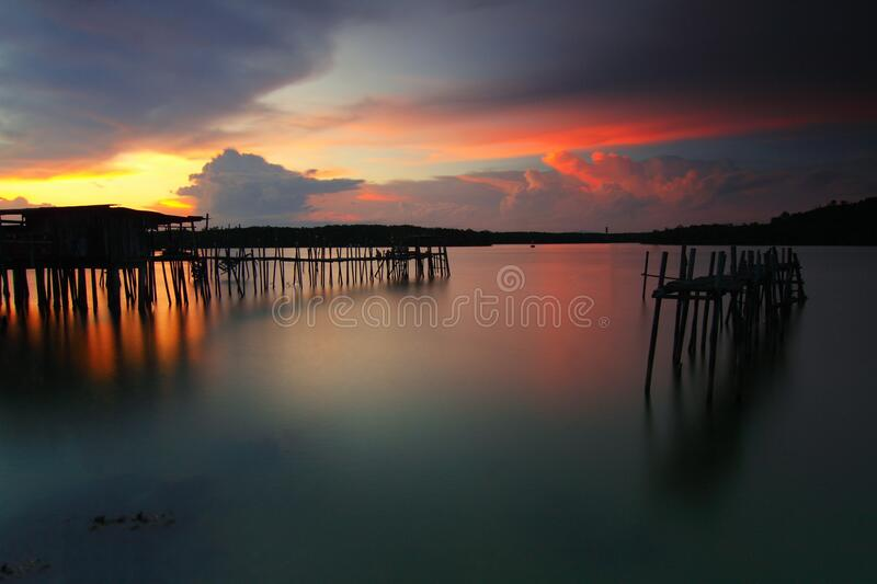 Wooden Boardwalk On Body Of Water During Dawn Free Public Domain Cc0 Image