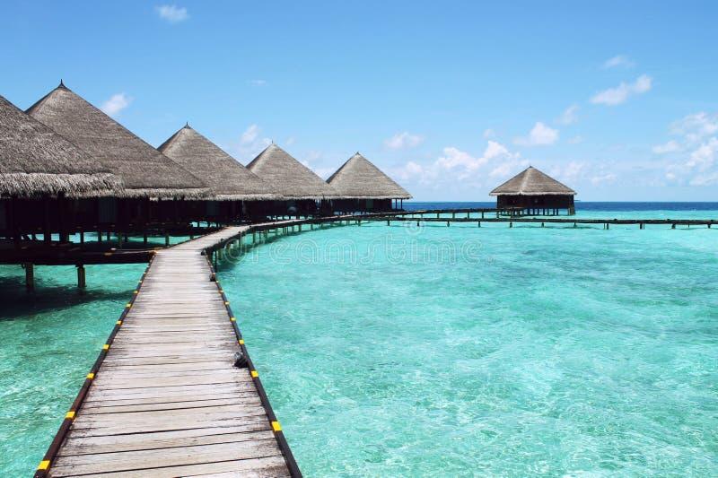 Wooden boardwalk and bungalows, Tahiti stock photo