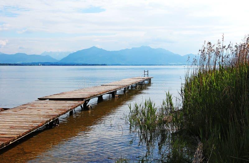 Wooden boardwalk at chiemsee lake, bavaria royalty free stock photos
