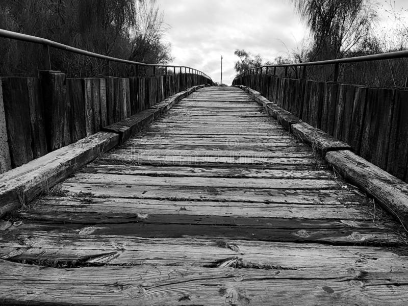 Isla Cristina`s wooden boardwalk, black and white. Wooden boardwalk Isla Cristina province of Huelva, Spain royalty free stock images