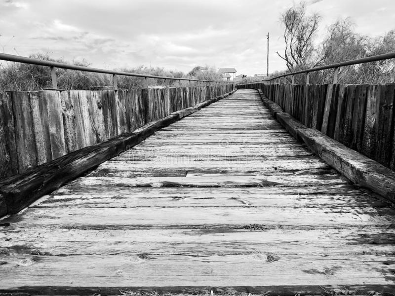 Isla Cristina`s wooden boardwalk, black and white. Wooden boardwalk Isla Cristina province of Huelva, Spain royalty free stock image