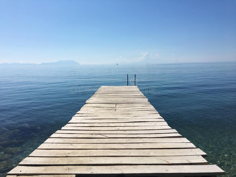 Wooden boardwalk on the sea stock images